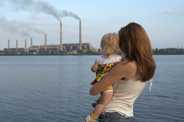 Mother and child at coal plant